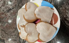 A plate of iced gingerbread cookies.
