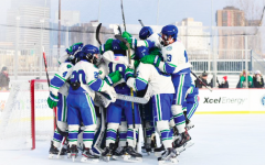 Players celebrate with starting goalie Aksel Reid after their 3-2 victory over Blaine High School at Hockey Day Minnesota 2020.