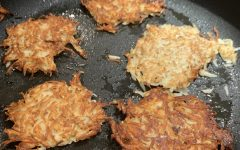 The latkes fry in a skillet with oil.