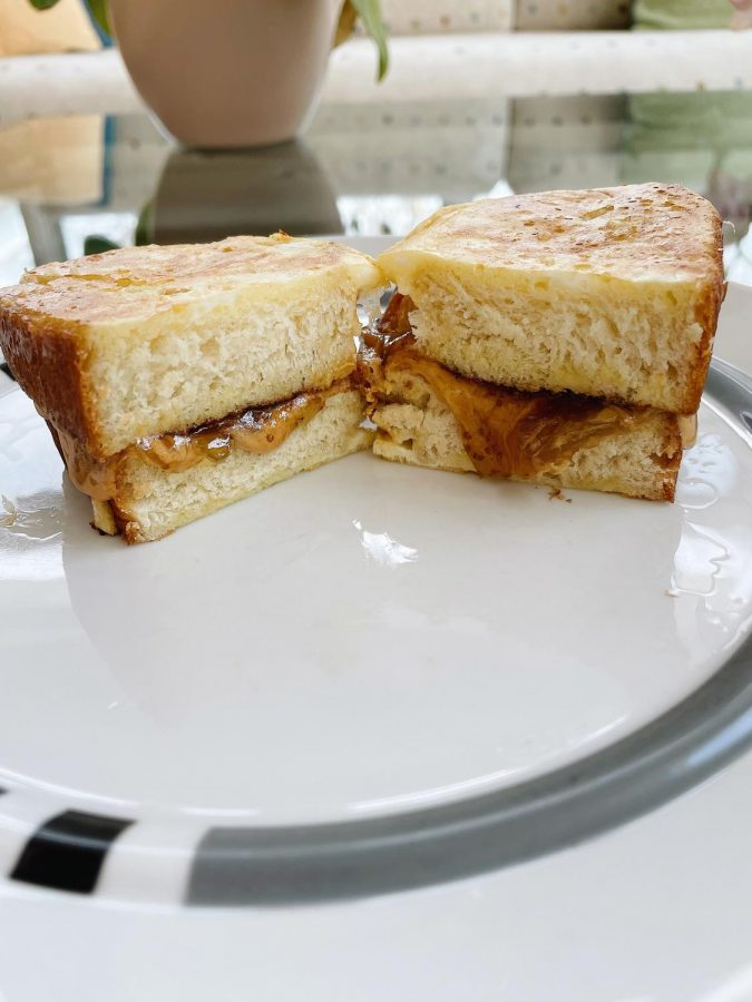 Challah bread and apricot jelly were used to make this sandwich, but you can use whatever type you'd like.