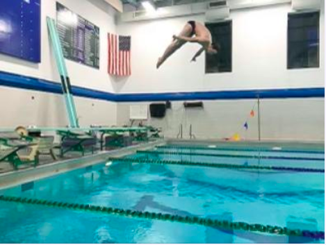 Collin Craig '24 preforms a dive during practice this season.