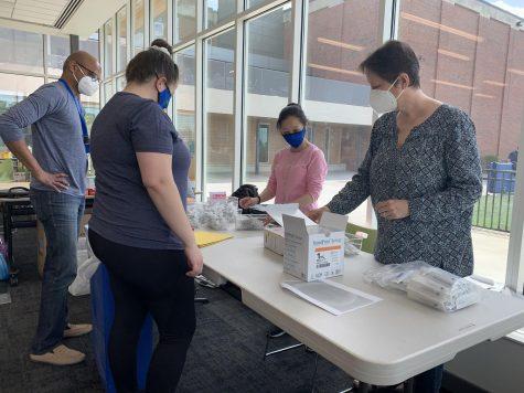 Parent volunteers gave vaccines to students.